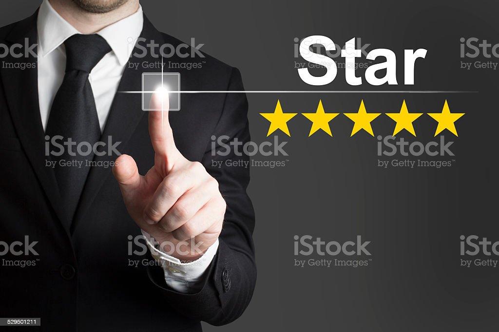 businessman pushing button star stock photo