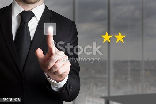 istock businessman pushing button two star rating 530481423
