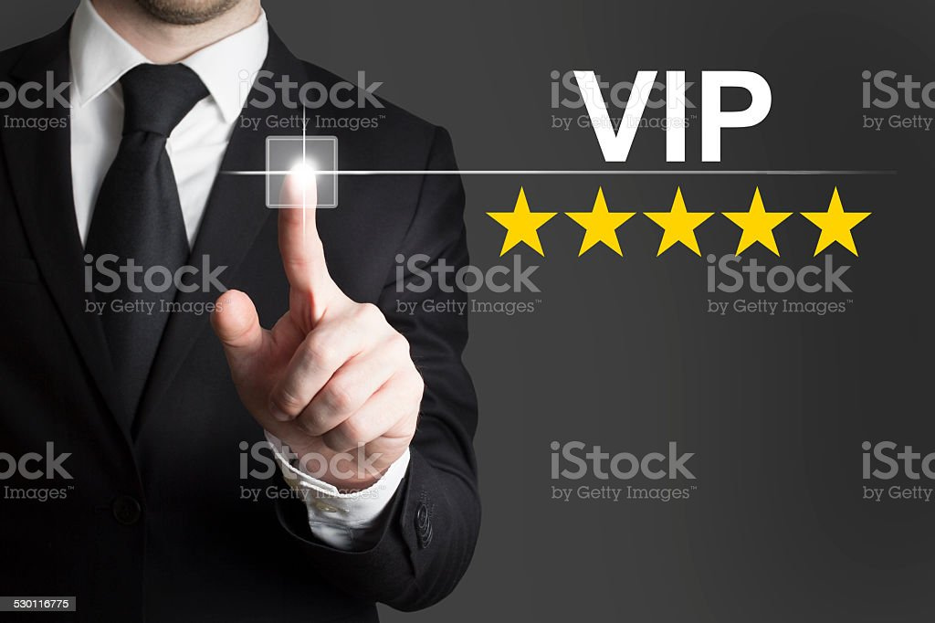 businessman pushing button vip five stars stock photo