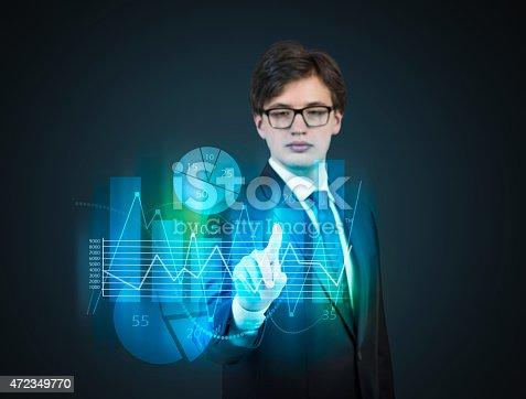 businessman pushing virtual chart in hand