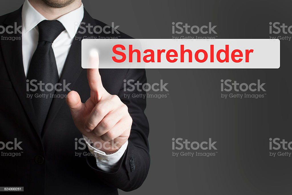 businessman pushing flat button shareholder stock photo