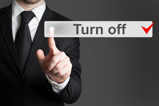 istock businessman pushing flat button turn off 524290601