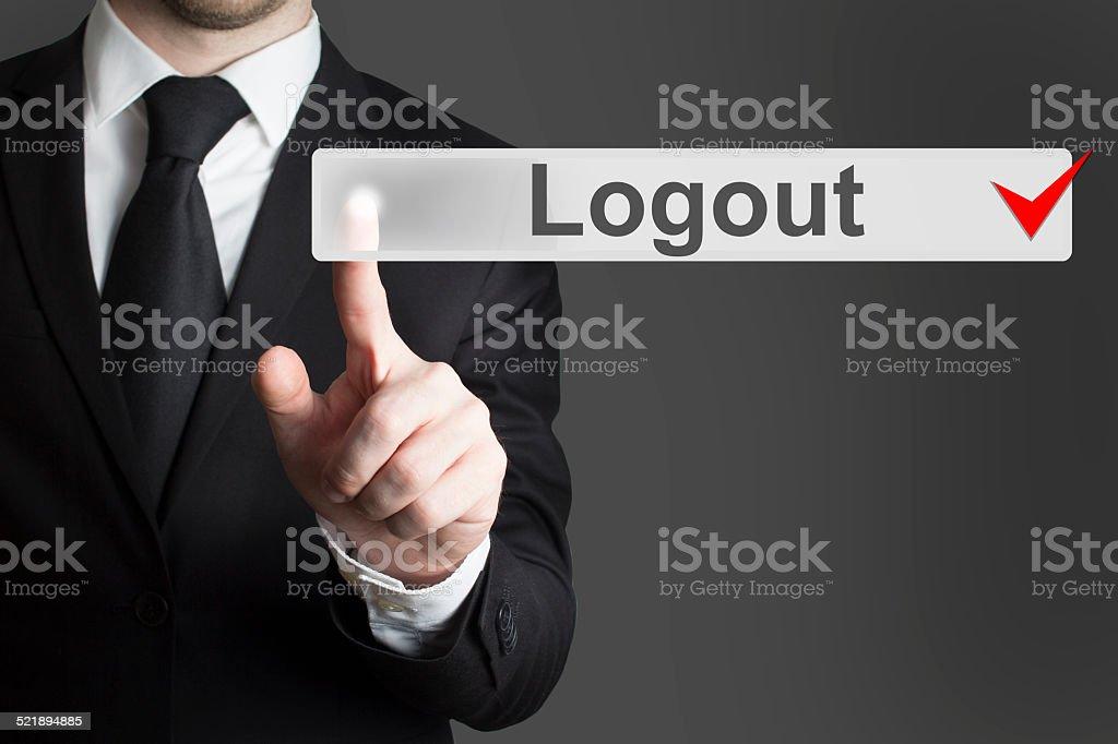businessman pushing flat touchscreen button logout stock photo