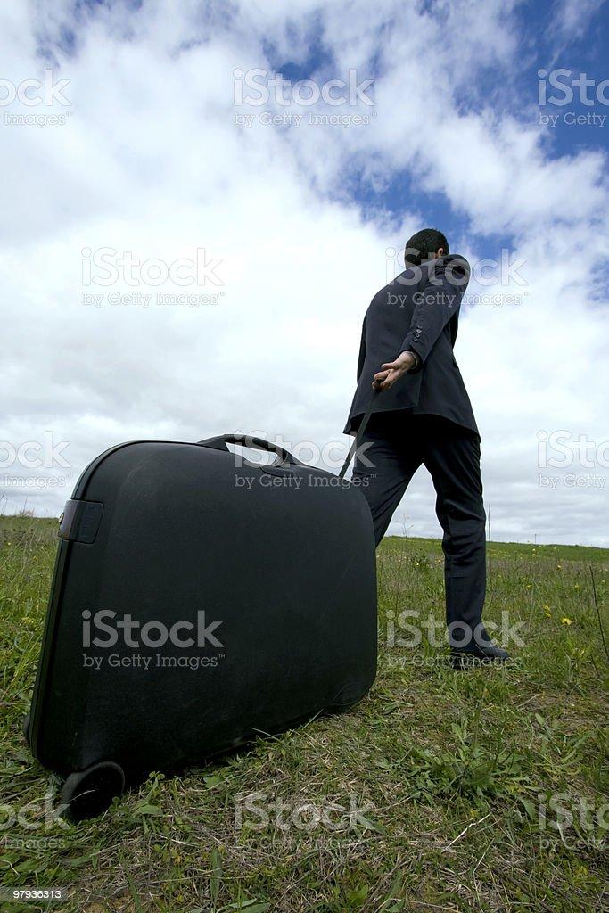 businessman pushing his baggage royalty-free stock photo