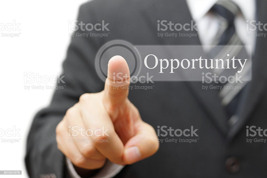Businessman pushing  Opportunity button on virtual button stock photo
