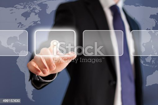 Businessman pushing touch screen button