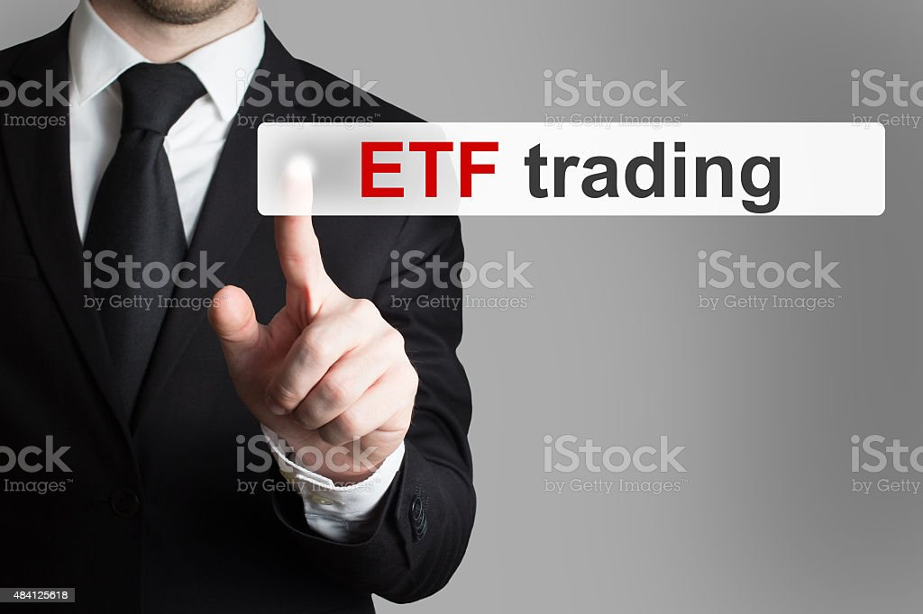 businessman pushing touchscreen button etf trading stock photo