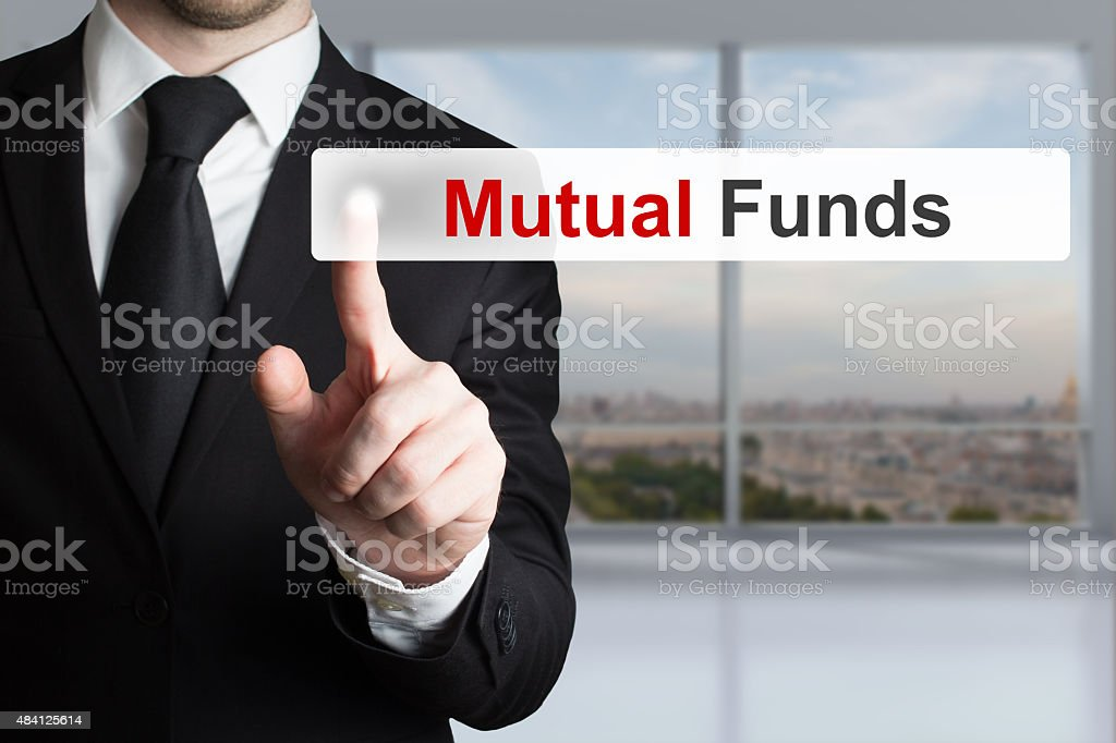 businessman pushing touchscreen button mutual funds stock photo