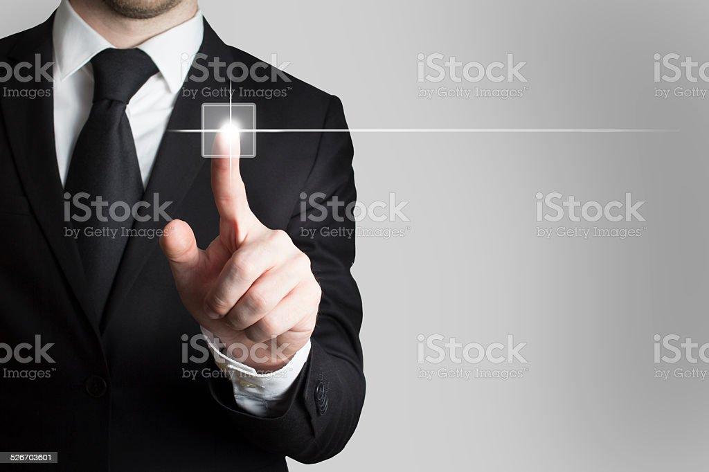 businessman pushing touchscreen button stock photo