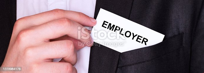 istock Businessman put card with text EMPLOYER in pocket. Business concept. 1223984176