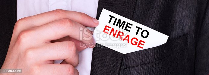 614338352 istock photo Businessman put card with text TIME TO ENRAGE in pocket. Business concept. 1223500036