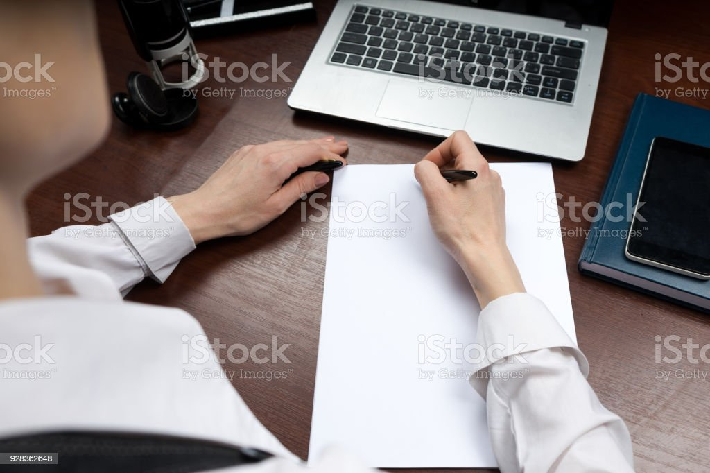 A businessman puts his signature on the contract. Copy space. stock photo