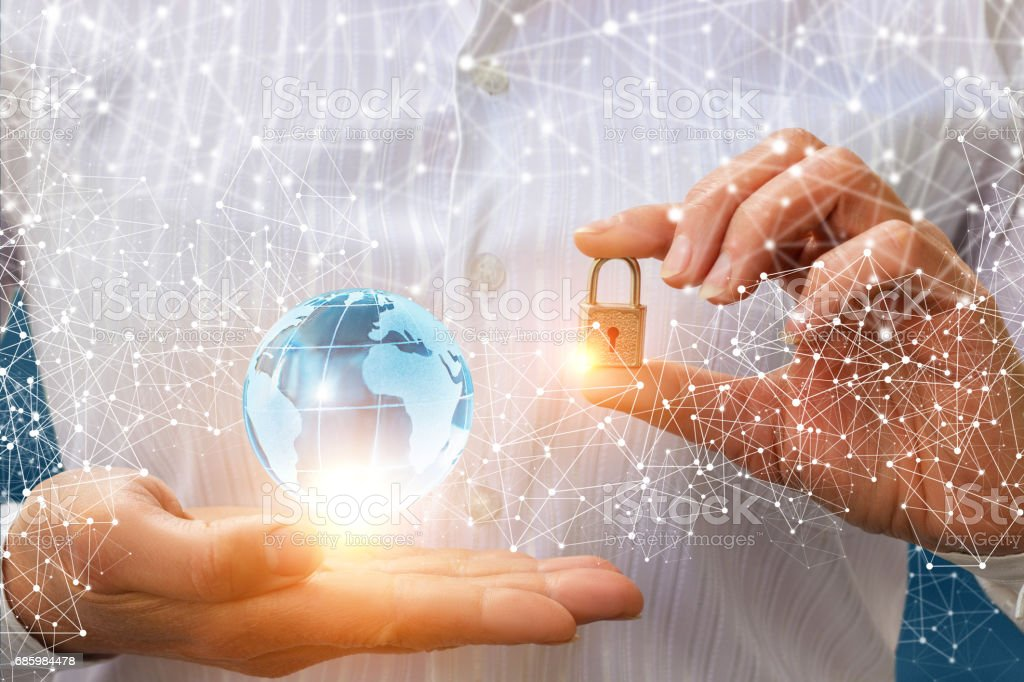 Businessman puts protection for the network. stock photo