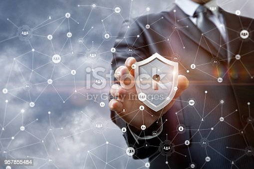 1156072209istockphoto Businessman puts security in the network . 957855484
