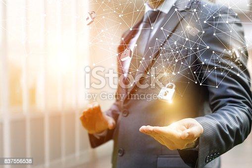 istock Businessman puts security locks on the network. 837556538