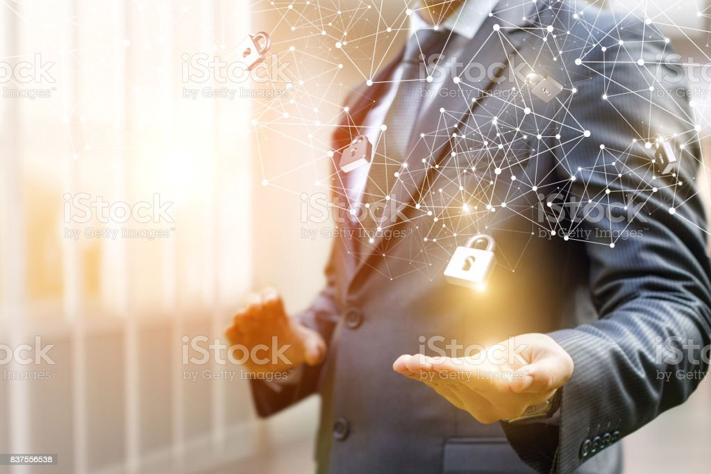 Businessman puts security locks on the network. stock photo
