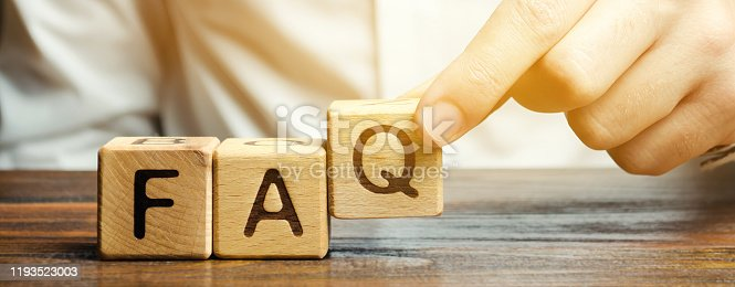 istock Businessman puts wooden blocks with the word FAQ (frequently asked questions). Collection of frequently asked questions on any topic and answers to them. Instructions and rules on Internet sites 1193523003