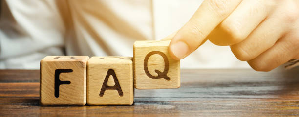 Businessman puts wooden blocks with the word FAQ (frequently asked questions). Collection of frequently asked questions on any topic and answers to them. Instructions and rules on Internet sites Businessman puts wooden blocks with the word FAQ (frequently asked questions). Collection of frequently asked questions on any topic and answers to them. Instructions and rules on Internet sites faq stock pictures, royalty-free photos & images