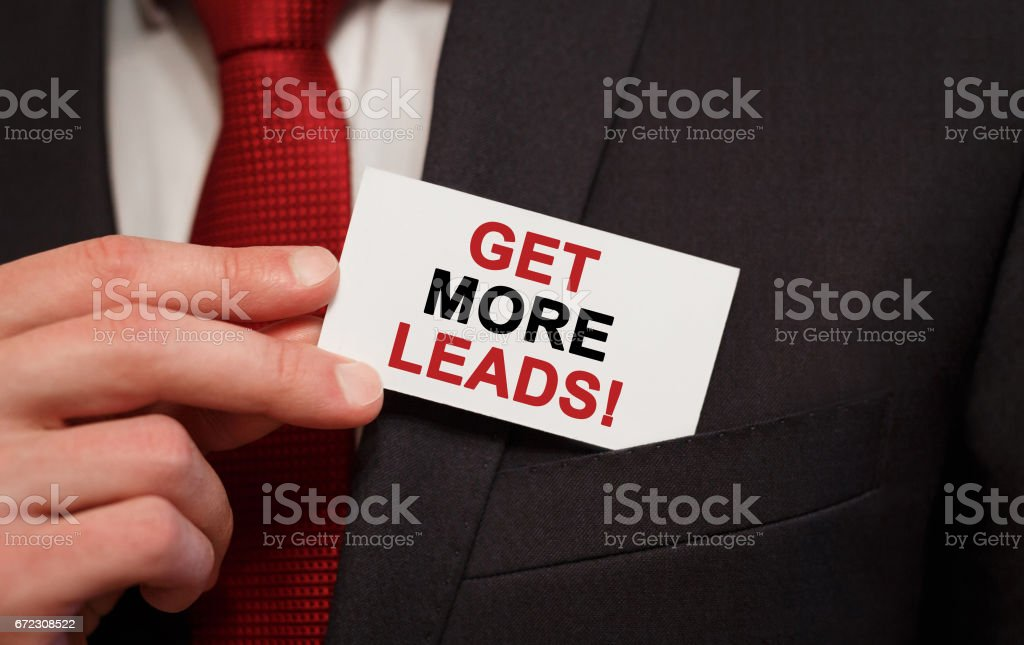 Businessman putting a card with text Get More Leads in the pocket stock photo
