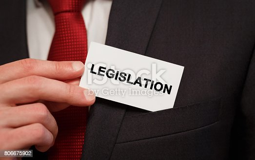 istock Businessman putting a card with text Legislation in the pocket 806675902
