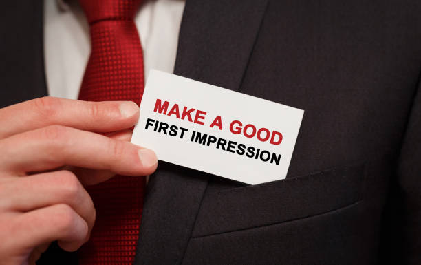 businessman putting a card with text make a good first impression in the pocket - number 1 stock pictures, royalty-free photos & images