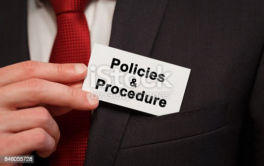 464906632 istock photo Businessman putting a card with text Policies and Procedure in the pocket 846055728
