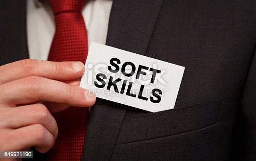 istock Businessman putting a card with text Soft Skills in the pocket 849921190