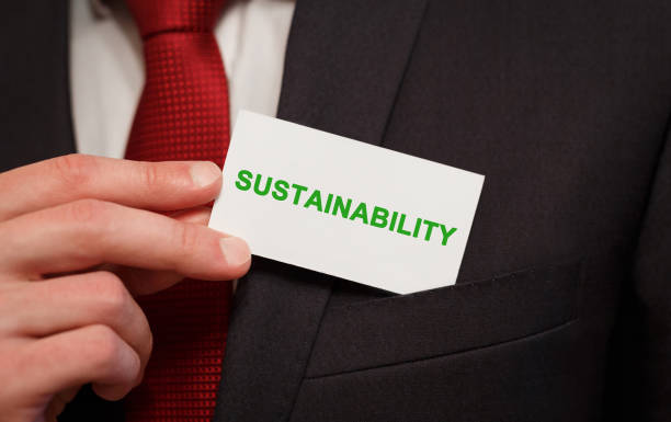 businessman putting a card with text sustainability in the pocket - teacher school solo imagens e fotografias de stock