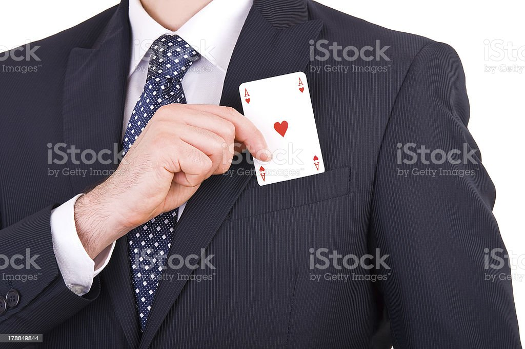 Businessman putting ace card in his pocket. stock photo