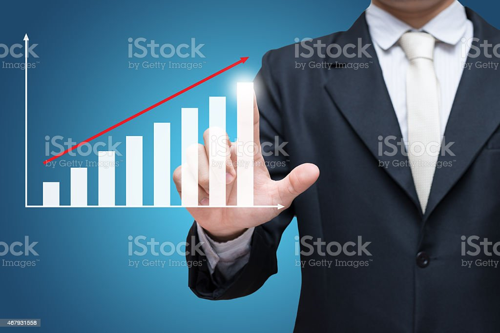 Businessman putting his finger on an animated finance graph stock photo