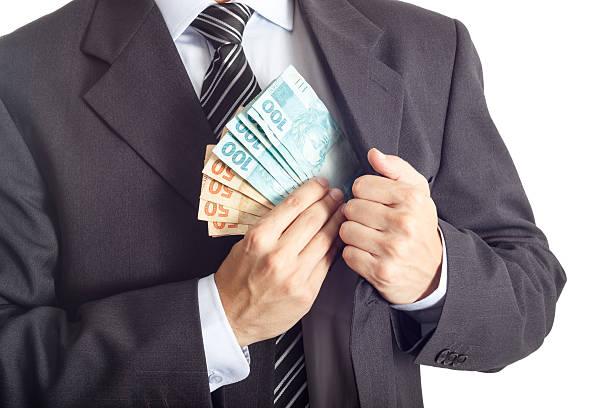 はめるビジネスマンお金でポケット - 腐敗 ストックフォトと画像