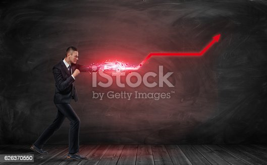 istock Businessman putting out hand like fighter and making red kinked 626370550