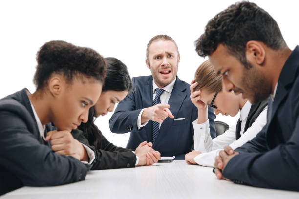 businessman quarreling at colleagues stock photo
