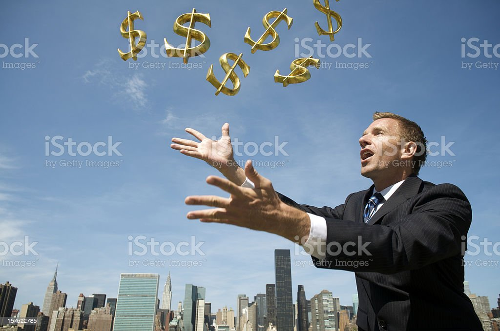 Businessman Reaches Out for a Shower of Dollars royalty-free stock photo