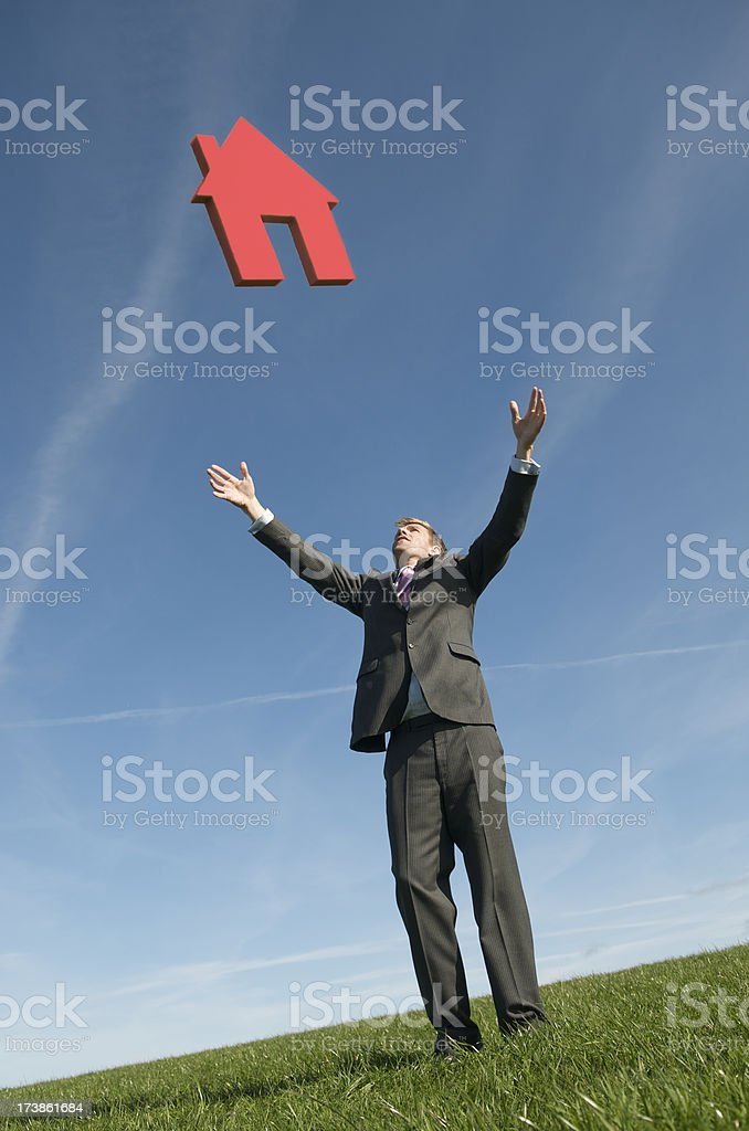 Businessman Reaches Out for House royalty-free stock photo