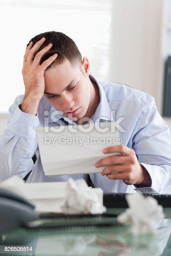 690496350istockphoto Businessman reading a bill 826505514