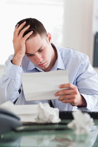 690496350 istock photo Businessman reading a bill 826505514