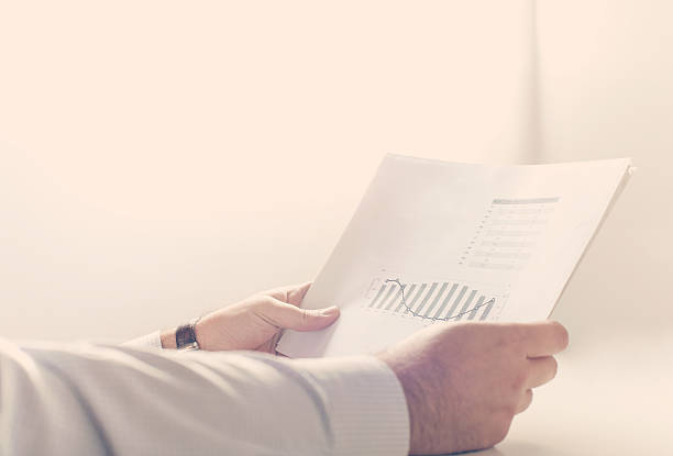 Businessman reading a business report stock photo