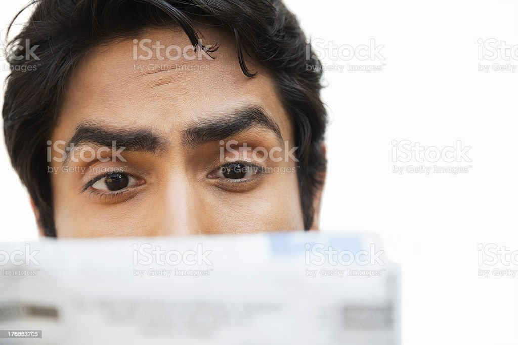 Businessman reading a newspaper royalty-free stock photo
