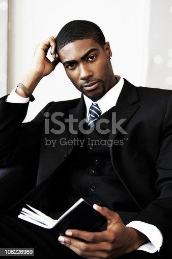 istock Businessman Reading Book 108226989