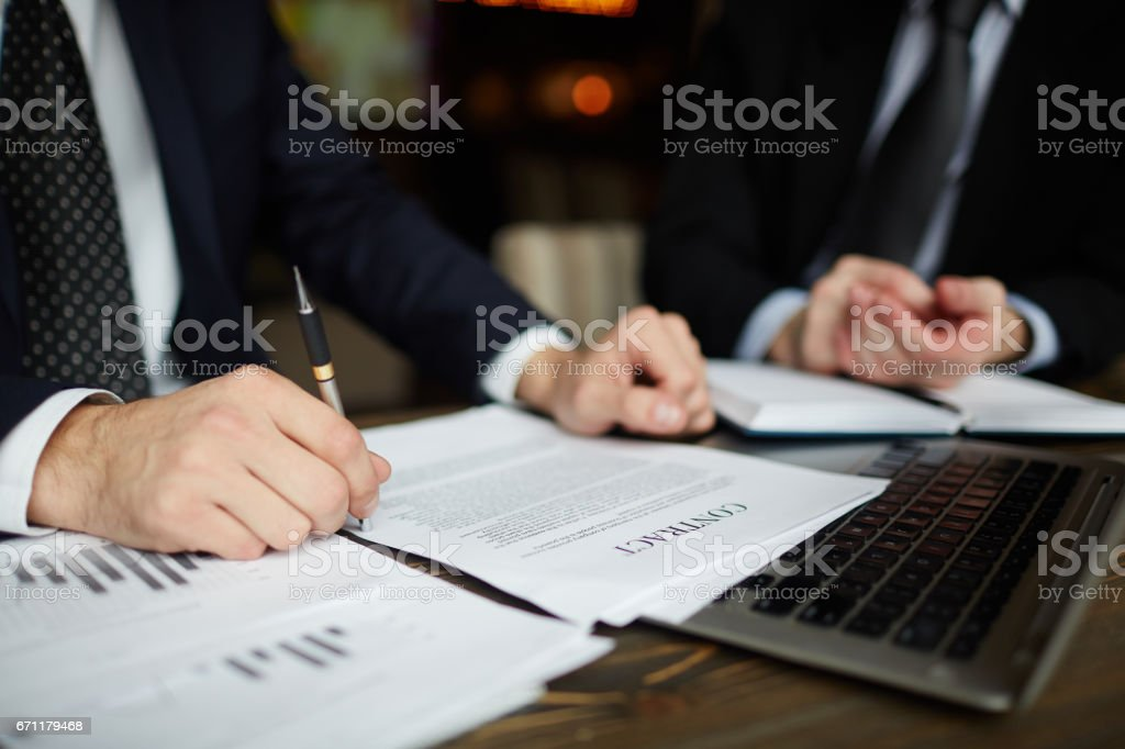 Businessman Reading Contract Closeup stock photo