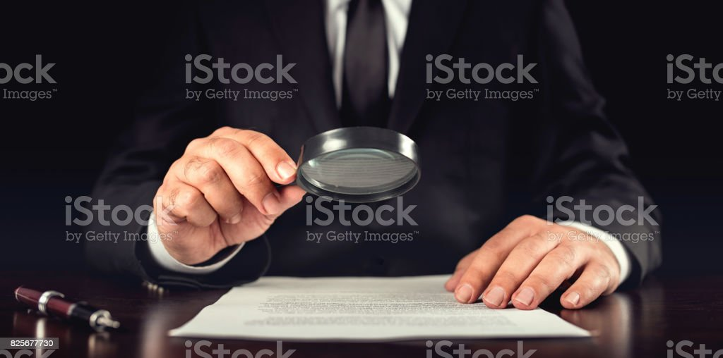 Businessman Reading Contract Details Before Signing stock photo