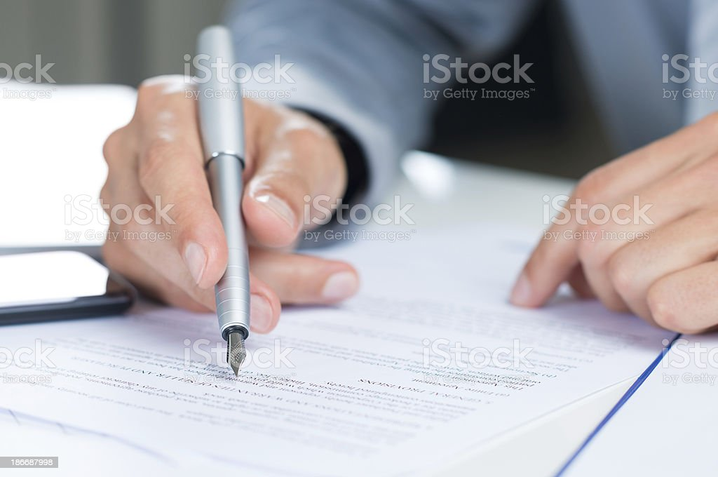 Businessman Reading Contract stock photo