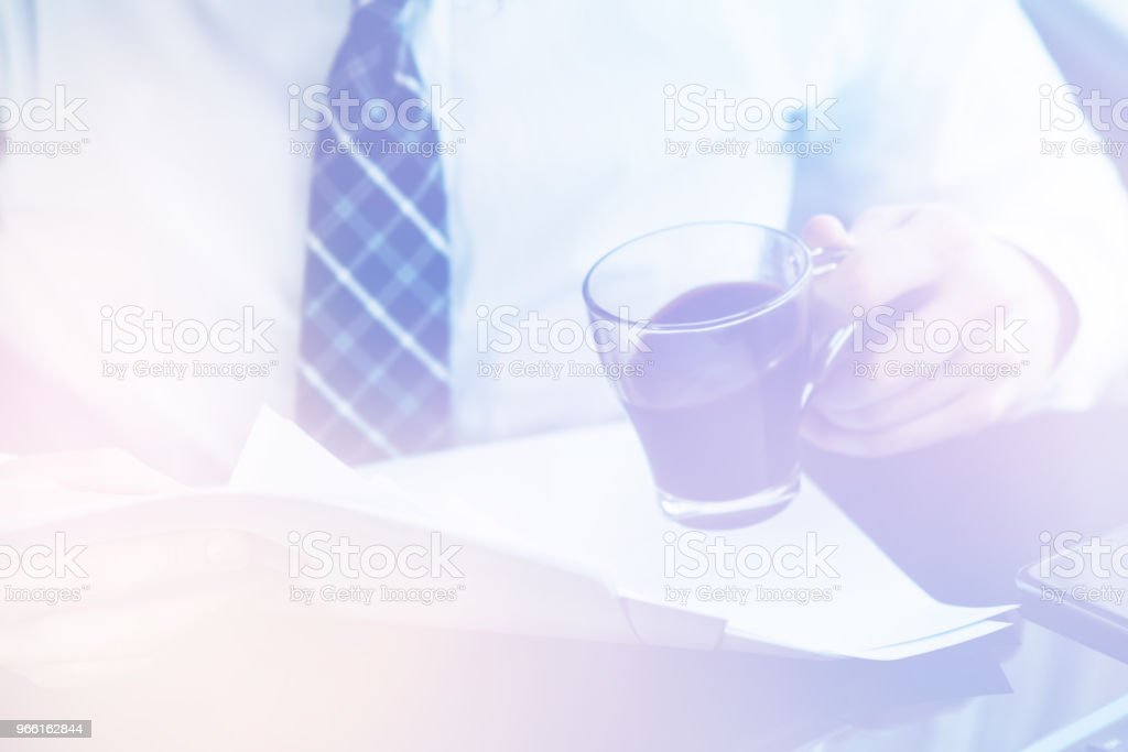 Businessman reading documents Light toning - Royalty-free Agreement Stock Photo