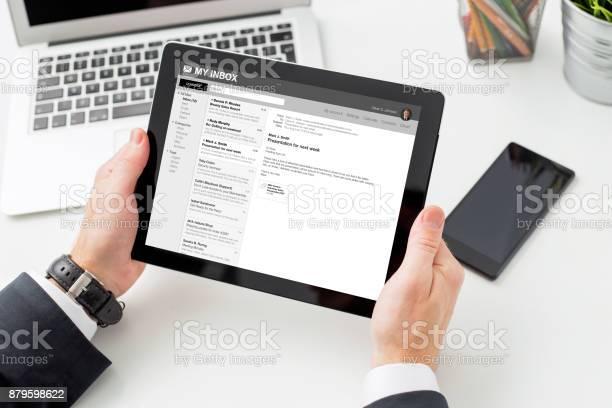 Businessman reading email on tablet computer picture id879598622?b=1&k=6&m=879598622&s=612x612&h=nz5x9lx rpvr38buev fmk5tynqvwglzqkvec3ytjl8=