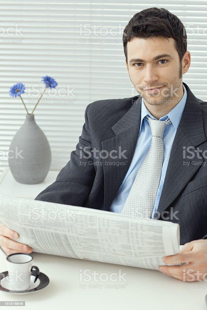 Businessman reading news royalty-free stock photo