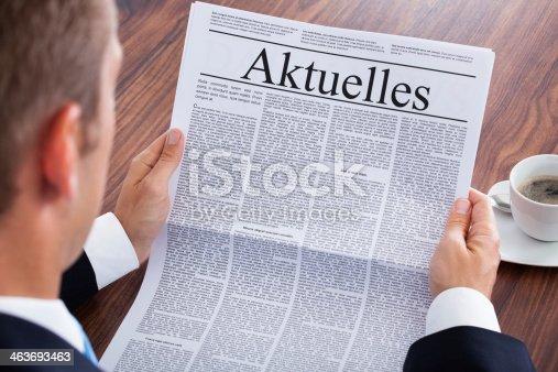 istock Businessman Reading Newspaper 463693463
