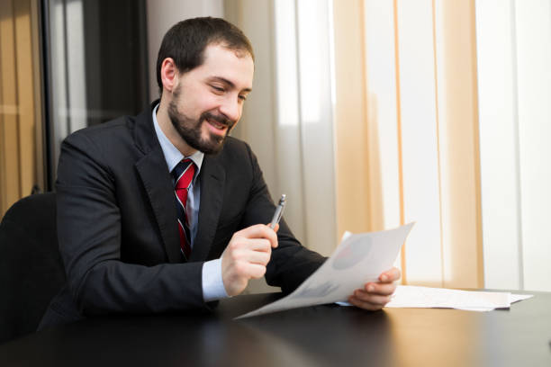Businessman reading some documents stock photo