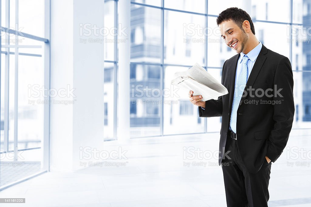 Businessman reading the news royalty-free stock photo
