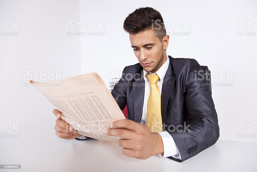 Businessman reading the newspaper royalty-free stock photo